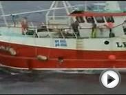UK fishing boat dumping unwanted fish into the sea